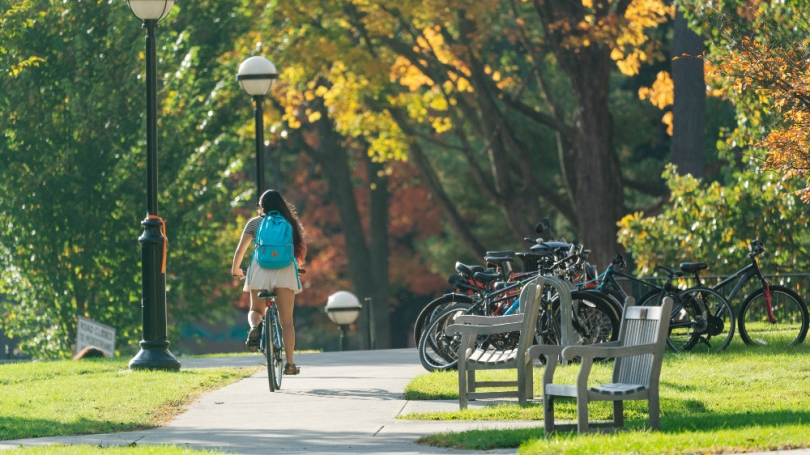Girl riding bike on the Green