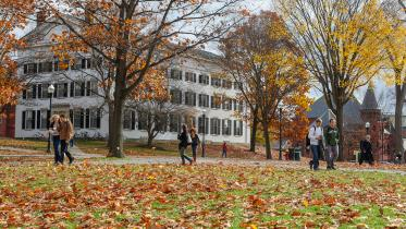 Students walk through campus in the fall.