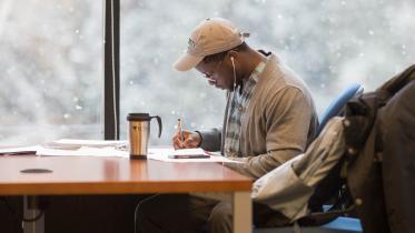 A student studies at Tuck's Feldberg Library