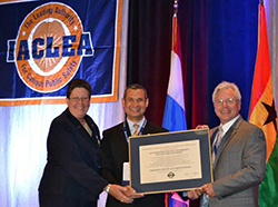 Accepting the IACLEA certificate of accreditation from IACLEA