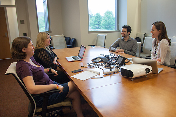 From left: STEPS President Erin Shoemaker-Kiess discusses science policy initiatives with fellow graduate students Amanda Socha, Nicholas Warren, and Julia Bradley-Cook. (Photo by Corinne Arndt Girouard)
