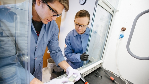 a man and woman working in a lab