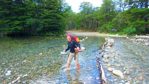 Flora Krivak-Tetley wading in a creek