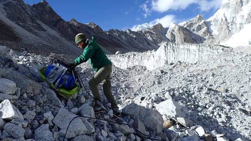 Photo caption: Alexandra Giese taking ground penetrating radar measurements on the Changri Nup glacier in Nepal, 17,500' above sea leve)