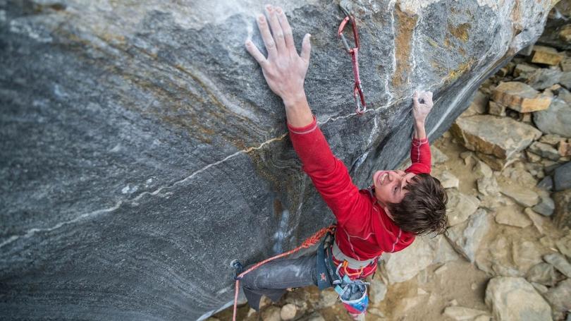 Zebediah Engberg, a graduate student in the mathematics department, rock climbing