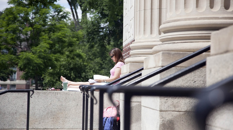 MALS student Laura Burgess works on her thesis in front of Rauner Library