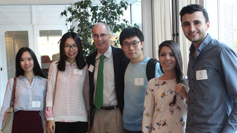 President Phil Hanlon and several incoming graduate students