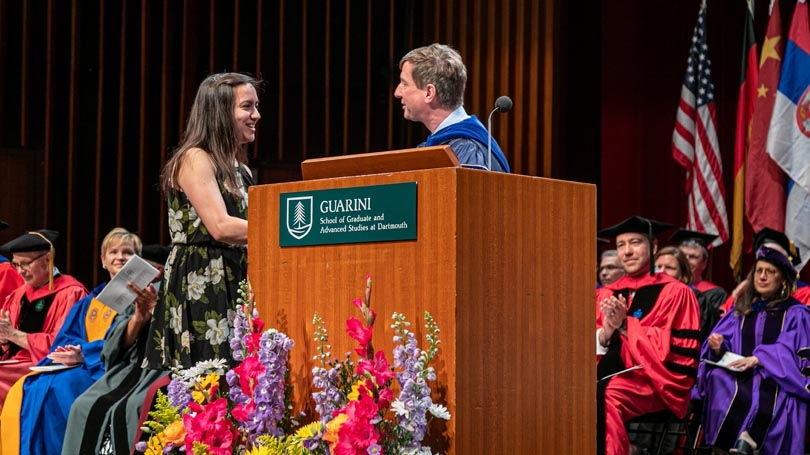 Sally Demirdjian receives the Community award from Dean Jon Kull on stage