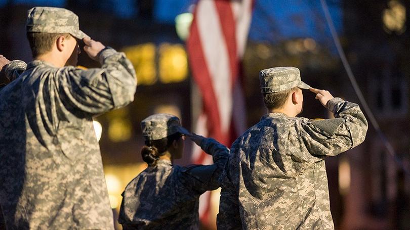 Dartmouth ROTC members salute the flag.
