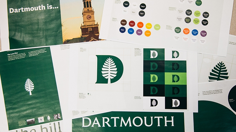 a pile of papers with Dartmouth's new logo on them