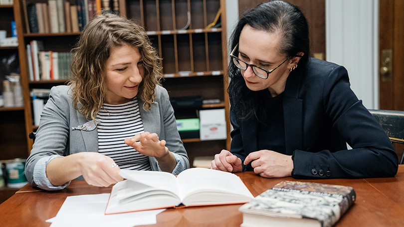Tetiana Savchynska (left) confers with her adviser, Yuliya Komska, an associate professor of German.