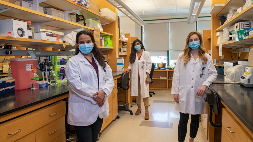 Project Leads for the team winning the top award are, from left, Arti Gaur, assistant professor of neurology at Geisel; Divya Ravi, Guarini '24, and Jordan Isaacs, Guarini '24, both PhD students in the Cancer Biology Program.